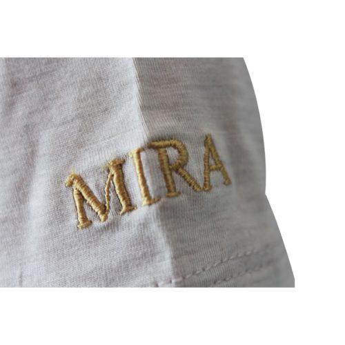 cucitura mira su maglietta grigia, tipo fibra argento